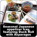 Seasonal Japanese appetizer tray, featuring Duck Roll with Asparagus